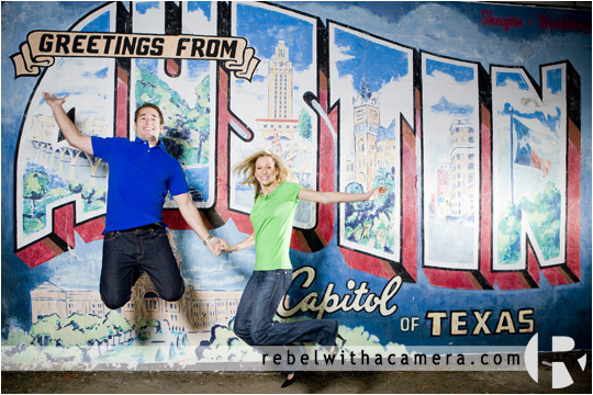 Wes and Kina have their engagement portraits photographed at the Greetings From Austin sign in South Austin, TX