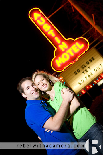Wes and Kina have their engagement portraits photographed at the Austin Hotel sign in South Austin, TX