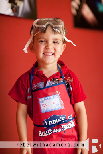 Kids photography in Austin at it's best. Corbin dressed up in an adorable Lowes apron and goggles given to him at Lowes in Austin, Texas