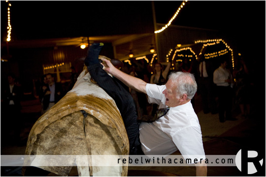 Mechanical bull riding wedding pictures in Columbus Texas for Bret and Estella.