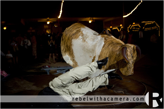 wedding party rides mechanical bull pictures in Columbus Texas for Bret and Estella.
