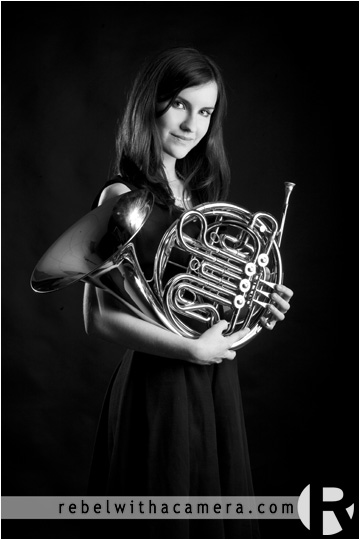 Cool and fun senior portraits in Austin, Texas at the Texas Capital and the Rebel with a camera studio in North Austin.  French horn is in picture.