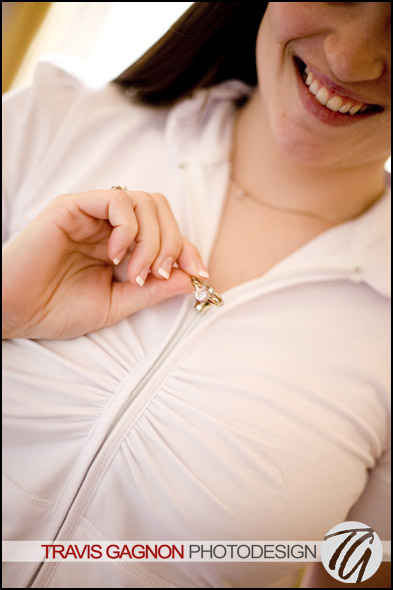 Caire plays with her zipper during getting ready for her wedding at the Driskill hotel in Austin, Texas