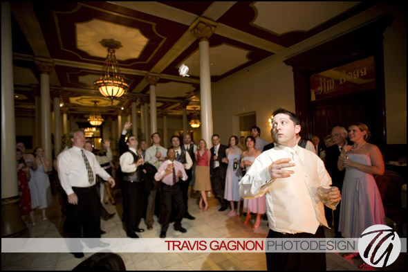 Jeremy throws the garter during his and Claire's wedding at the Driskill hotel in Austin, Texas