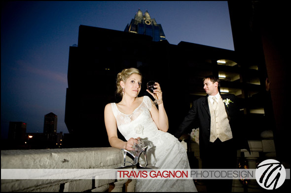 Laura and Justin hang out on the balcony of the LBJ room at their wedding at the Driskill hotel in Austin, Texas