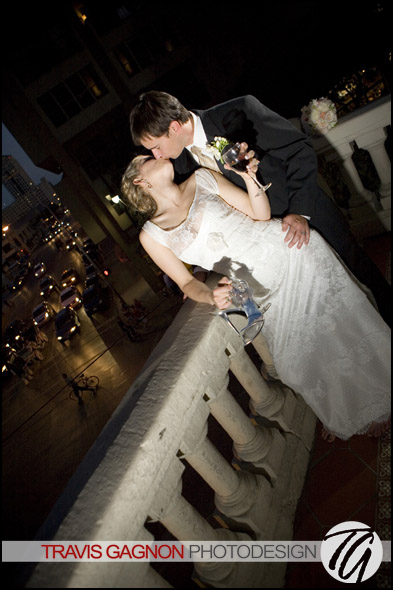 Laura and Justin kiss while on the balcony of the LBJ room during their  wedding at the Driskill hotel in Austin, Texas