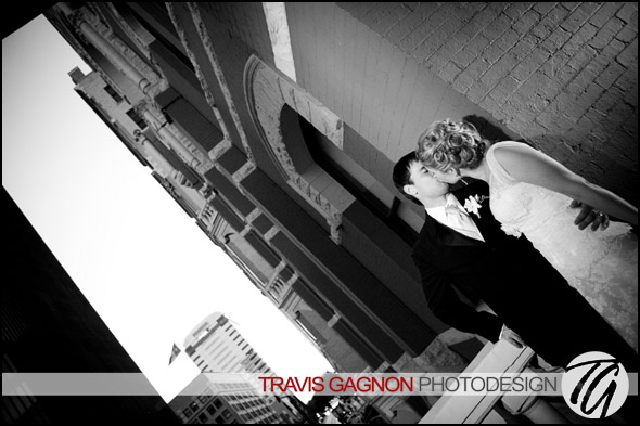 Laura and Justin kiss in front of the hotel during their wedding at the Driskill hotel in Austin, Texas