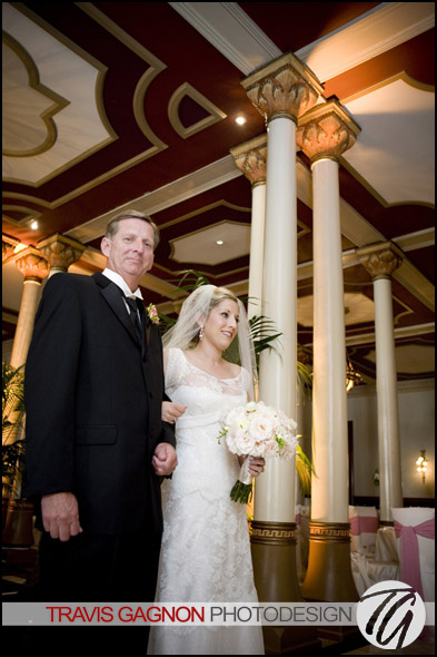 Laura and her father as they enter the ceremony during Laura and Justin's wedding at the Driskill hotel in Austin, Texas