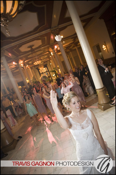 Laura throws the bouquet during Laura and Justin's wedding at the Driskill hotel in Austin, Texas