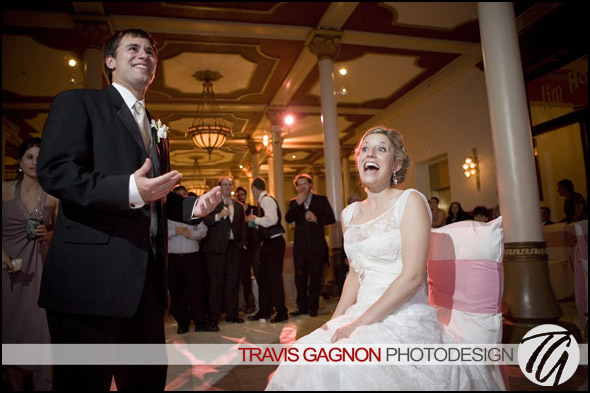 Laura and Justin laugh about the garter toss during their wedding at the Driskill hotel in Austin, Texas